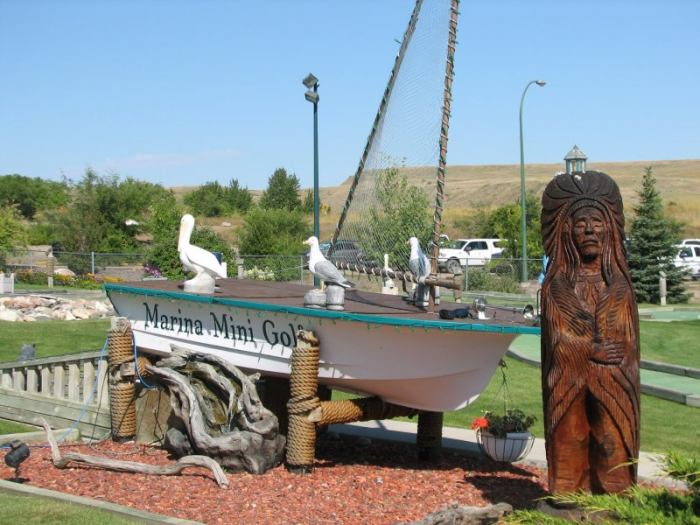 Marina Mini Golf, with a beautiful setting of flower beds, shrubs, trees, large pond with waterfall and fountain